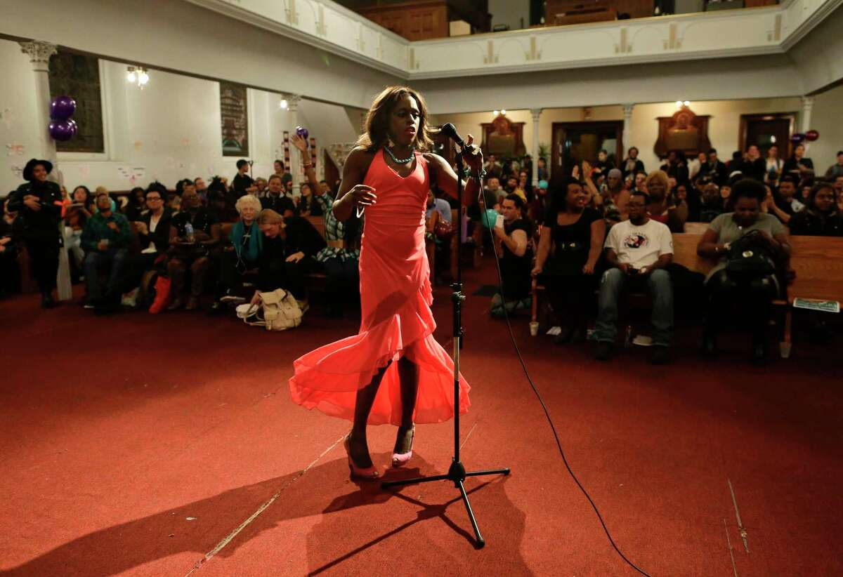 In this photo taken on Nov. 18, 2015, Sheeneneh Smith, a transgender woman, performs during a Trans Day of Remembrance program. While Caitlyn Jenner made the cover of Vanity Fair and Laverne Cox prospered as a popular actress, other transgender women have become homicide victims at an alarming rate, with 22 killings so far this year.