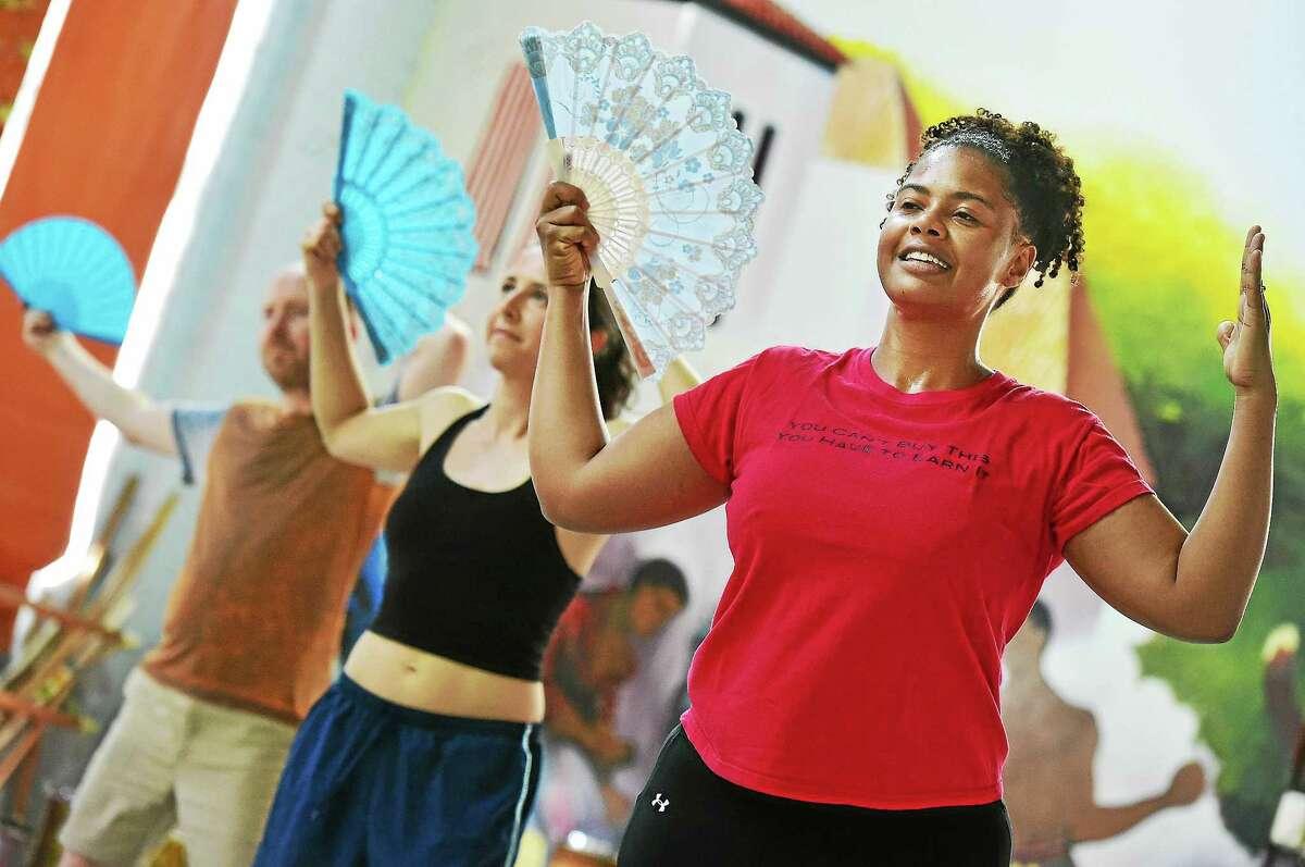 Kristina Douglass dances orixa mix with the dance fan in the samba class, Thursday, June 25, 2015, at Connecticut Capoeira Dance Center in New Haven.