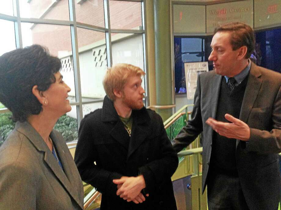 Southern Connecticut State University President Mary Papazian, senior Shayne O'Brien and Edward Harcourt, pro-vice-chancellor of Liverpool John Moores University, chat Tuesday. Photo: Ed Stannard — New Haven Register