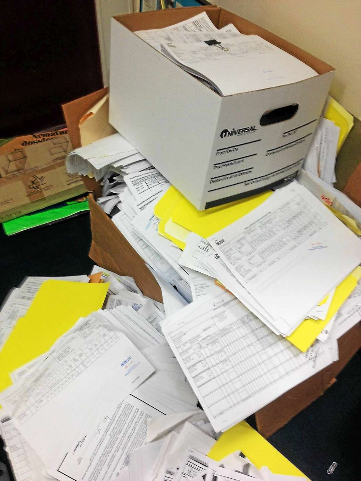 Payroll records in the New Haven CEO office July 30, before being shredded.