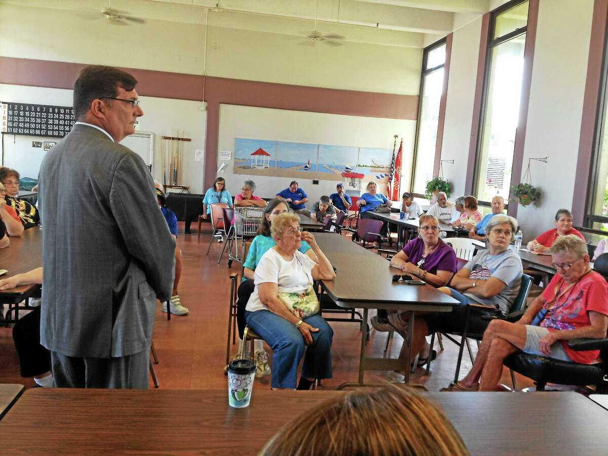 West Haven Mayor Ed O'Brien talks with residents at the Surfside public housing complex Wednesday.