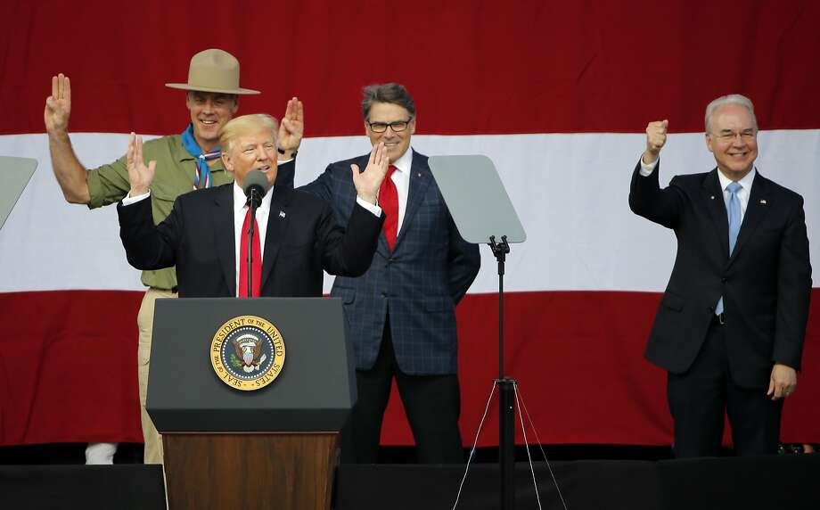 President Donald Trump, front left, gestures with former boys scouts, Interior Secretary Ryan Zinke, left, Energy Secretary Rick Perry, center, and Secretary of Health and Human Services Tom Price, right, at the 2017 National Boy Scout Jamboree at the Summit in Glen Jean,W. Va., Monday, July 24, 2017. (AP Photo/Steve Helber) Photo: Steve Helber, Associated Press