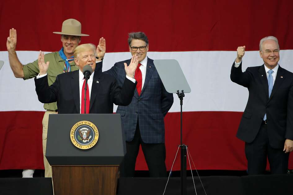 President Donald Trump, front left, gestures with former boys scouts, Interior Secretary Ryan Zinke, left, Energy Secretary Rick Perry, center, and Secretary of Health and Human Services Tom Price, right, at the 2017 National Boy Scout Jamboree at the Summit in Glen Jean,W. Va., Monday, July 24, 2017. (AP Photo/Steve Helber)