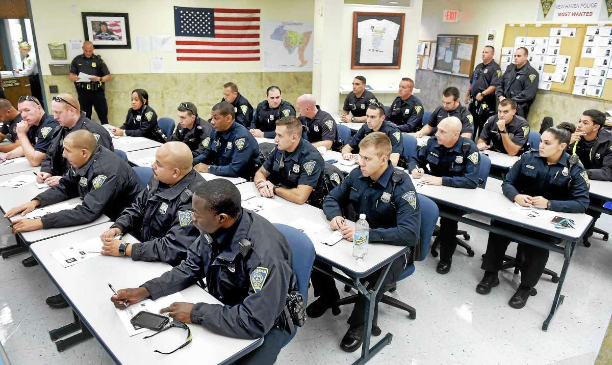 (Arnold Gold-New Haven Register) Patrol officers attend roll call at the beginning of their shift at the New Haven Police Department on 10/23/2015.