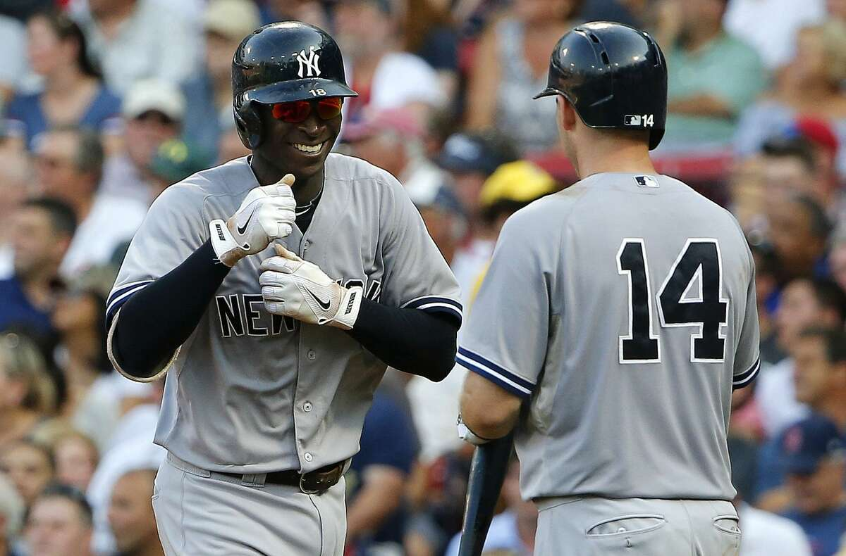 The Yankees' Didi Gregorius smiles as he is greeted by teammate Stephen Drew (14) after his home run against the Boston Red Sox.