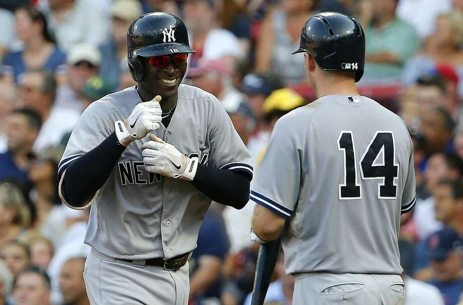 The Yankees' Didi Gregorius smiles as he is greeted by teammate Stephen Drew (14) after his home run against the Boston Red Sox. Photo: Winslow Townson  — The Associated Press   / FR170221 AP