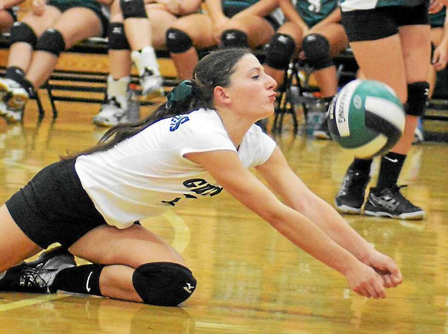 Guilford's Sam Shank digs up a shot during a game last season. Photo: File Photo By Dave Phillips -- GameTime CT