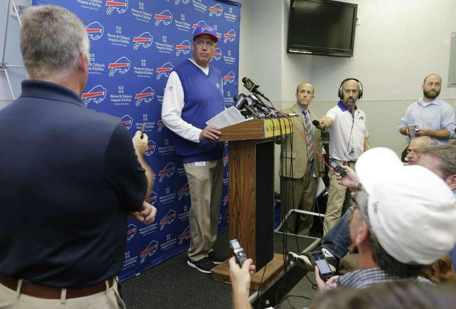 Bills head coach Rex Ryan, center, speaks to members of the media. Photo: The Associated Press   / AP