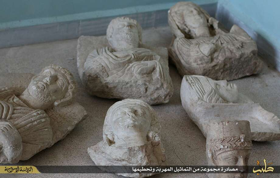 """This image posted on a militant website by the Aleppo branch of the Islamic State group on Friday, July 3, 2015, which has been verified and is consistent with other AP reporting, shows items that the group claims are six smuggled archaeological pieces from the historic central town of Palmyra. An IS statement says the busts were found when the smuggler was stopped at a checkpoint and was later referred to an Islamic which ordered that they be destroyed and the man be whipped. Arabic on the caption reads, ìa collection of smuggled statues was destroyed."""" (militant website via AP) Photo: AP / militant website"""
