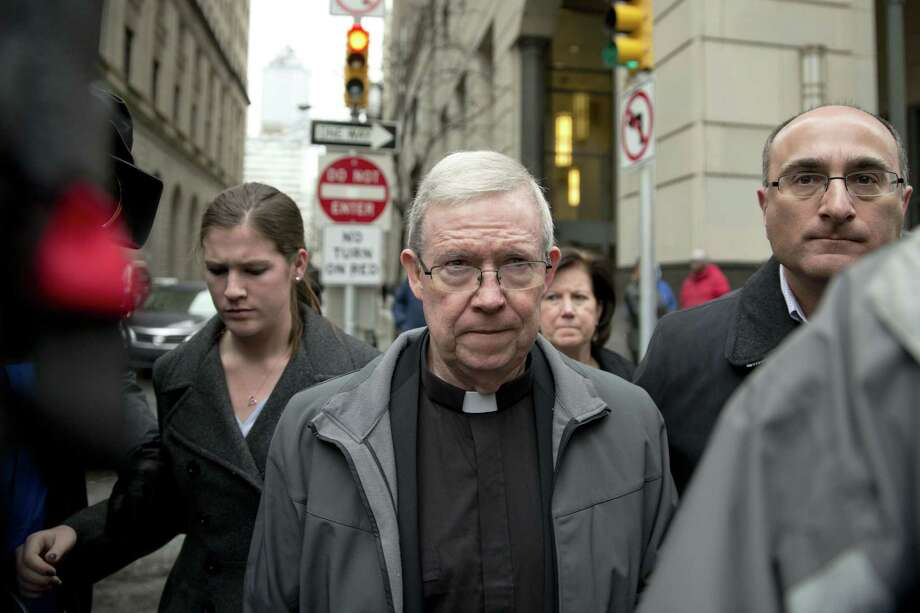 In this Jan. 6, 2014 file photo, Monsignor William Lynn walks from the criminal justice center after a bail hearing in Philadelphia. Lynn, a former church official jailed for his handling of priest sexual-abuse complaints, is housed in a Philadelphia prison that Pope Francis plans to visit during his U.S. trip. (AP Photo/Matt Rourke) Photo: AP / AP