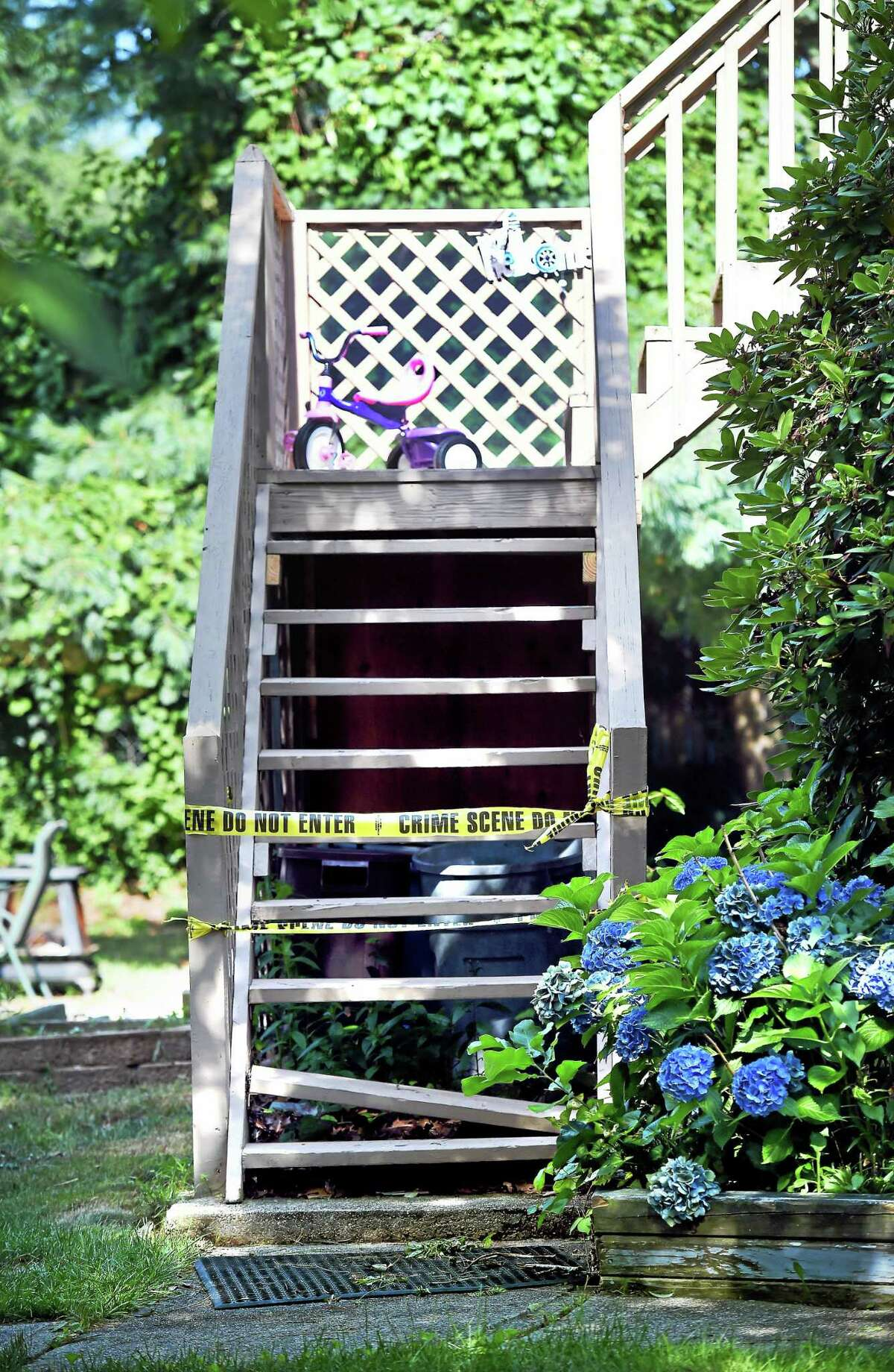 Crime scene tape blocks off an entrance at 80-82 Foxon Blvd. in East Haven Tuesday.