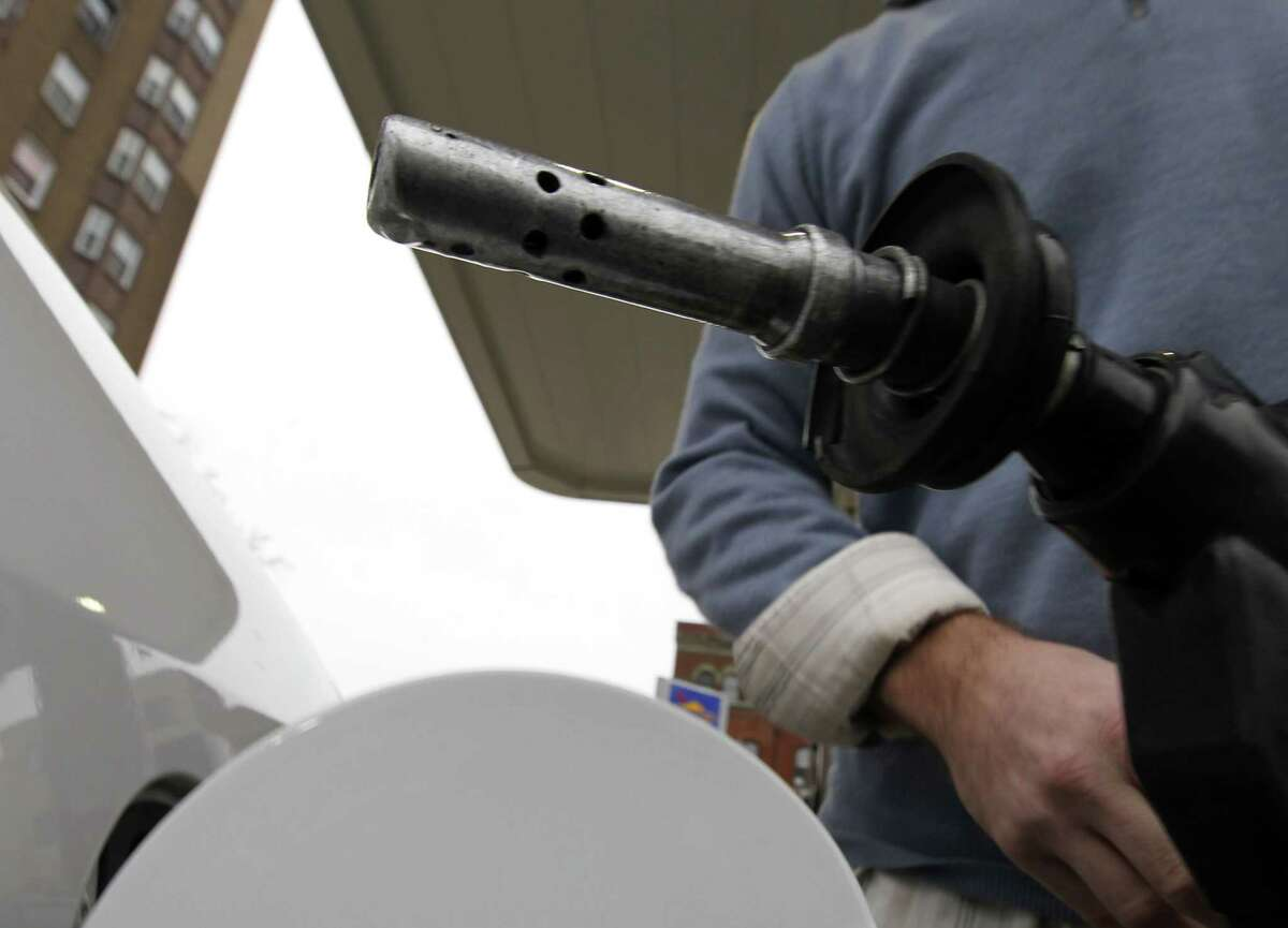 A drop of fuel hangs from the tip of a gas nozzle in Philadelphia in this 2012 file photo.