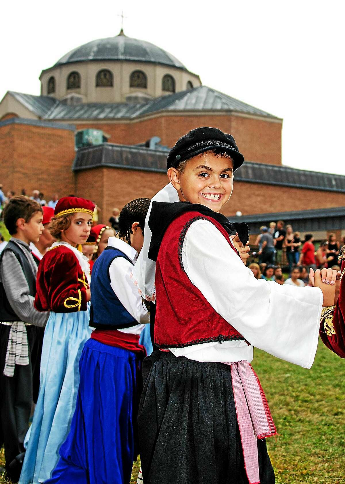 Photo: Patric Marchitto Odyssey Dancer Dino Spanolios of Bethany flashes a smile during a Greek dance performance at Odyssey 2014. Also picturedare Nicholas Kokenos of Shelton, left, Sofia Sanfilippo of Orange and John Dalakas (partially obscured) of Woodbridge. The troupe will perform several times daily at this yearís festival.