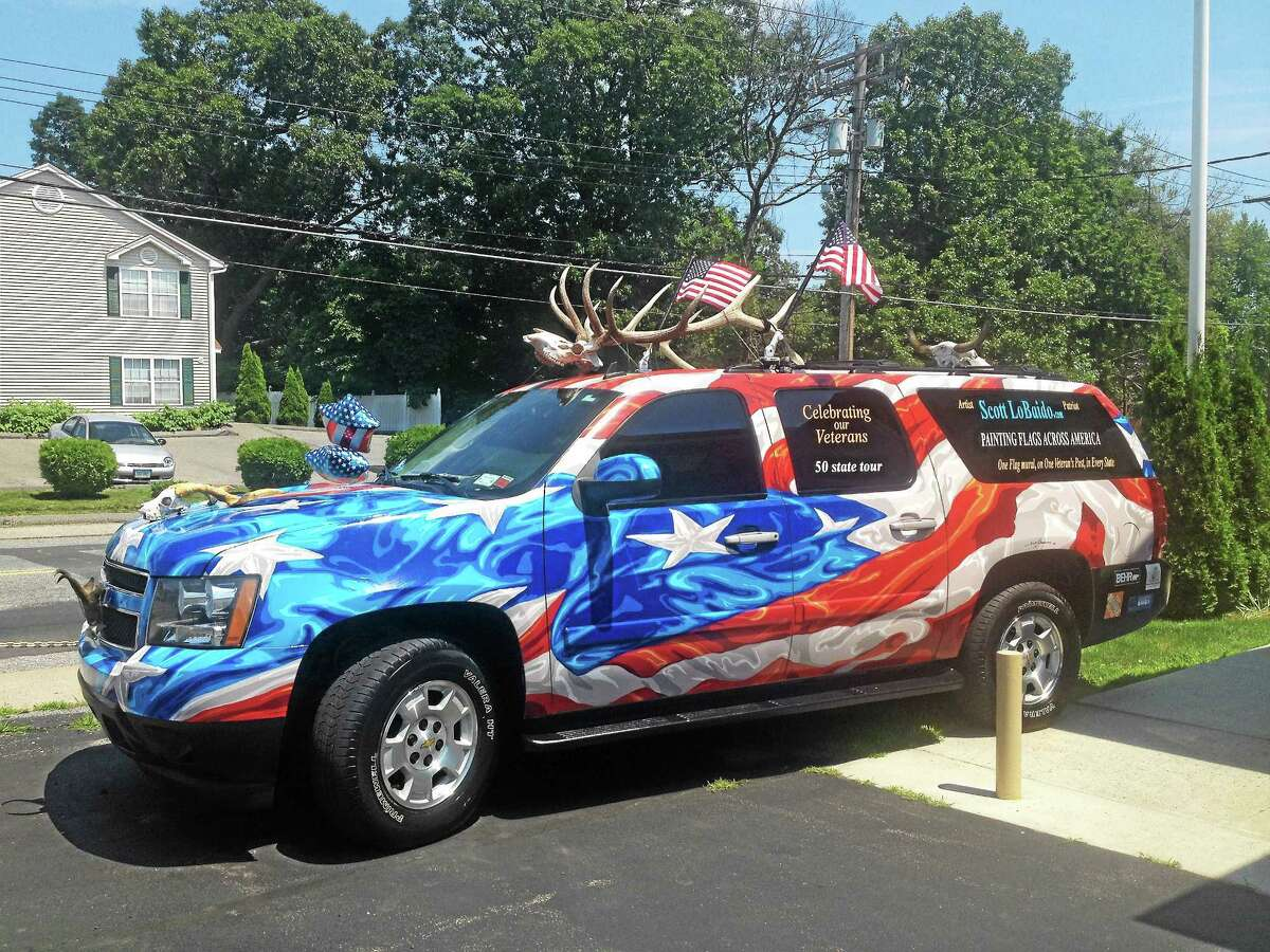 Artist Scott LoBaido travels the country in his patriotic loaded SUV.