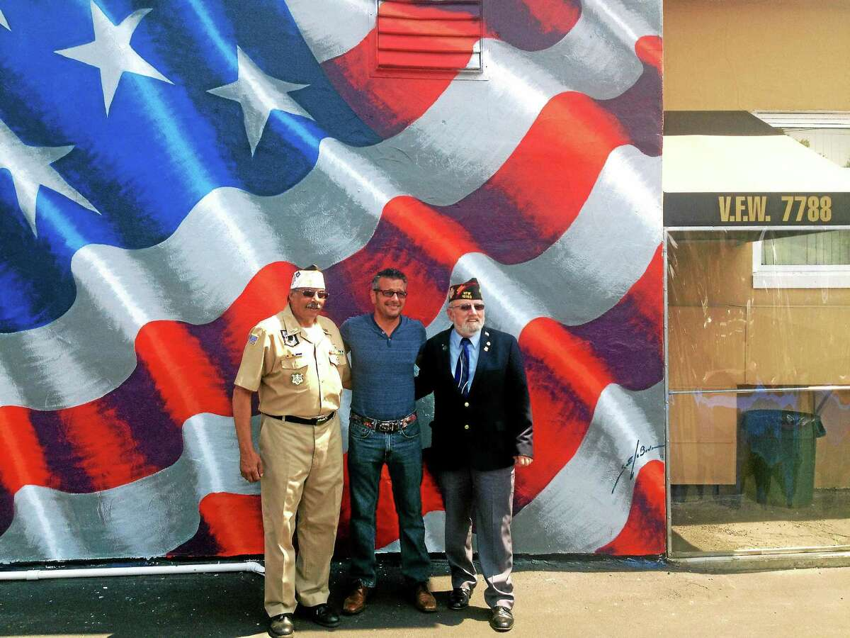 Artist Scott LoBaido, who is painting a flag on one veterans post building in each state, chose Milford's VFW Post 7788 on Naugatuck Avenue to represent Connecticut, his 33rd stop on the tour.