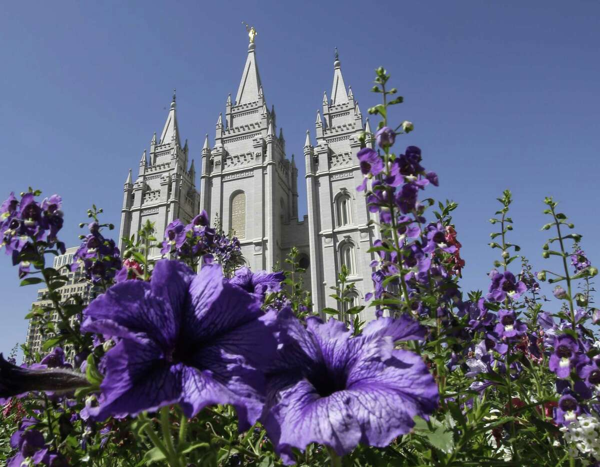 This Sept. 3, 2014, file photo shows flowers blooming in front of the Salt Lake Temple, at Temple Square, in Salt Lake City.