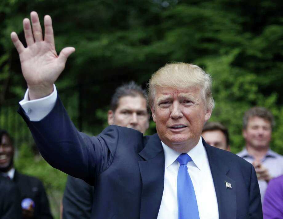 Republican presidential candidate Donald Trump waves as he arrives at a house party in Bedford, N.H.. earlier this week. Photo: Jim Cole — The Associated Press   / AP