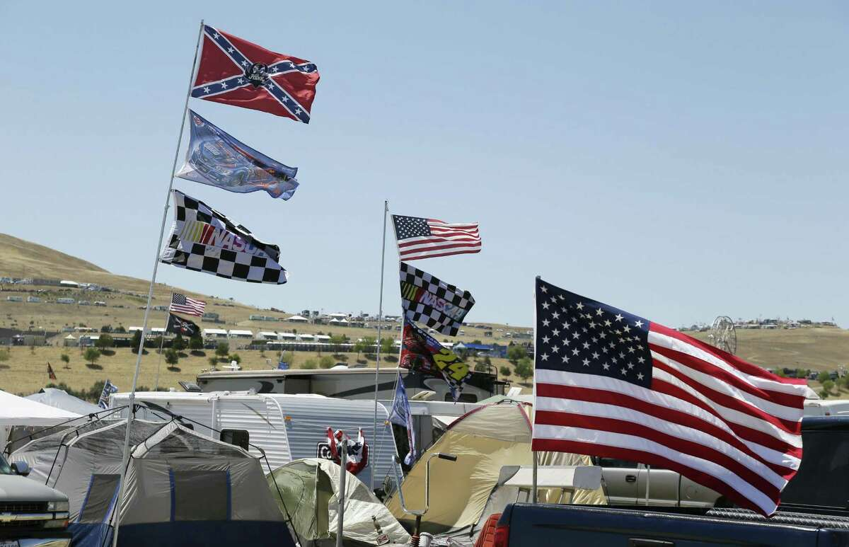 A Confederate flag flies outside the track during last Friday's practice for the NASCAR Sprint Cup race in Sonoma, Calif.