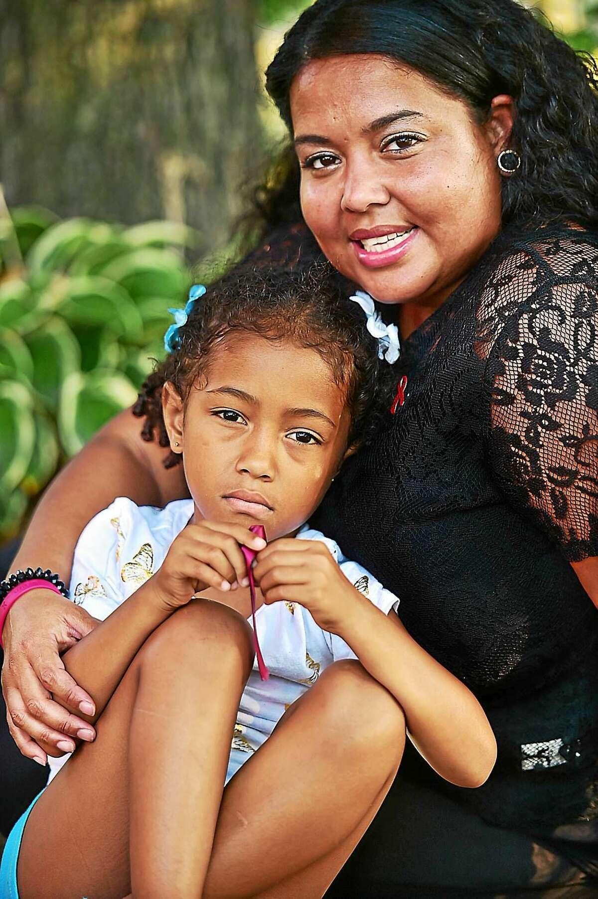 New Haven residents Amarilis Franjul and her 6-year-old daughter, Amarey Brookshire, following a press conference Wednesday at the Goffe Street Fire Station, for the upcoming sickle cell disease fundraising campaign in New Haven.