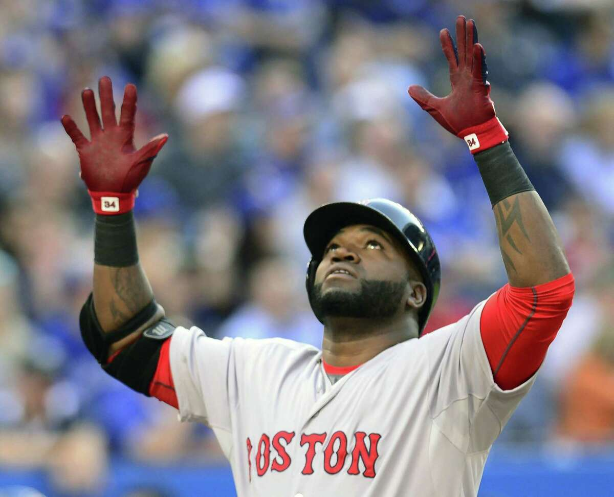 Red Sox DH David Ortiz celebrates his three-run home run in the first inning of Boston's 12-6 win over the Blue Jays on Thursday in Toronto.