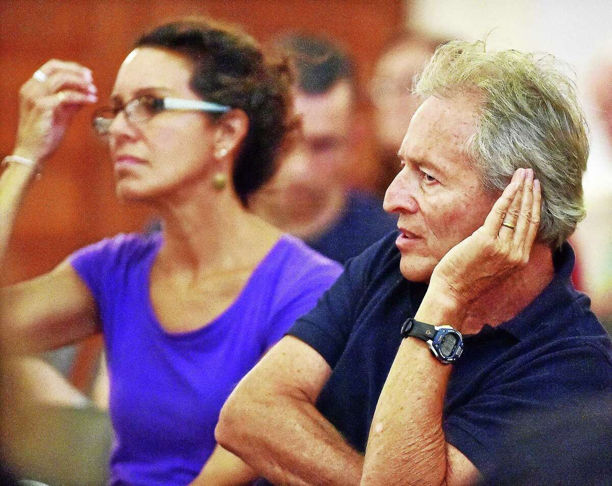 Milford residents Mark and Nancy Weber listen to members of the Planning and Zoning Board of Milford vote against the proposed 180-unit affordable housing complex Tuesday.
