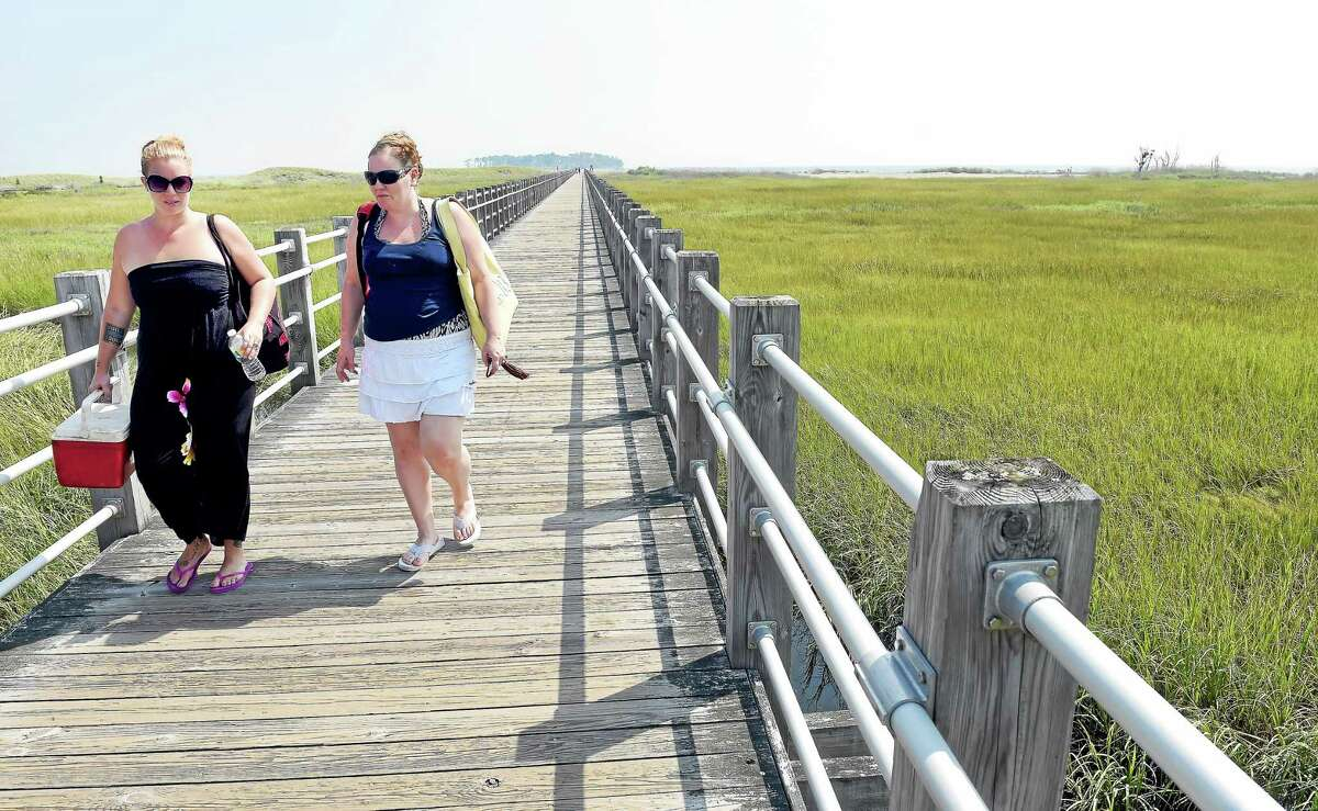 Missie Morris, far left, of Torrington and Lisa Sachen of Harwinton leave Silver Sands State Park in Milford on Sept. 2.