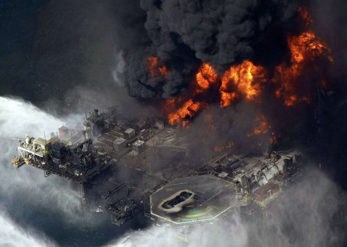FILE - In this April 21, 2010, file photo, the Deepwater Horizon oil rig burns in the Gulf of Mexico, more than 50 miles southeast of Venice, La. As part of the oil spill settlement, Mississippi would receive about $1.5 billion over 17 years, Republican Gov. Phil Bryant and Democratic Attorney General Jim Hood said Thursday. Added to $659 million in earlier funding, Mississippi would receive a total of about $2.2 billion, if the settlement is approved by a court. (AP Photo/Gerald Herbert, File)