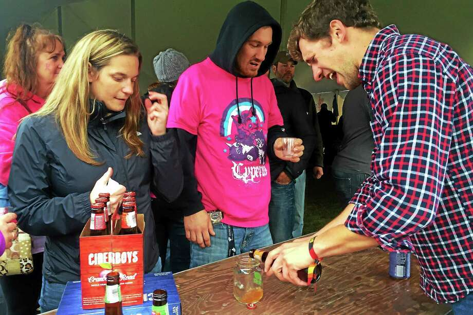 FILE: Attendees of the Smoke in the Valley Festival in Seymour sample Cider Boys hard cider. Close to 3,000 people attended the 2014 festival, which featured more than 400 types of beers. Photo: Esteban L. Hernandez — New Haven Register
