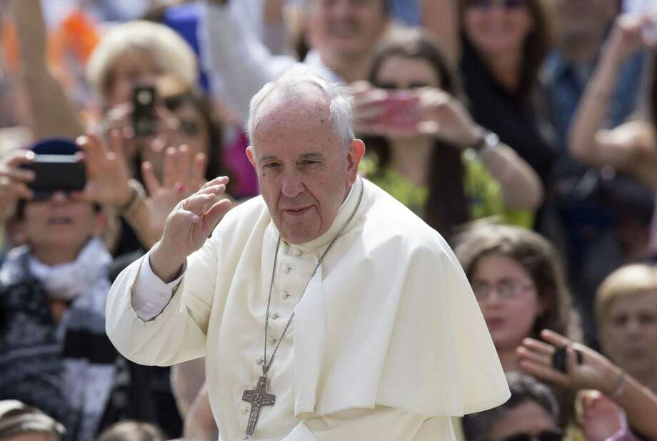 FILE - In this June 24, 2015, file photo, Pope Francis waves to the faithful as he arrives for his weekly general audience, in St. Peter's Square, at the Vatican. Roman Catholic leaders in the early voting state of Iowa will call July 2, on candidates for president to follow the teachings of Pope Francis and focus as much on the environment and income inequality in 2016 as they have in past elections on opposing gay marriage and abortion. (AP Photo/Riccardo De Luca, File) Photo: AP / AP