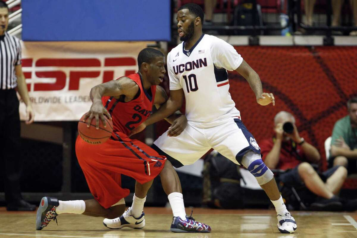 UConn guard Sam Cassell Jr., right, pressures Dayton guard Jordan Sibert during a NCAA college basketball game in San Juan, Puerto Rico, Friday, Nov. 21, 2014. (AP Photo/Ricardo Arduengo)