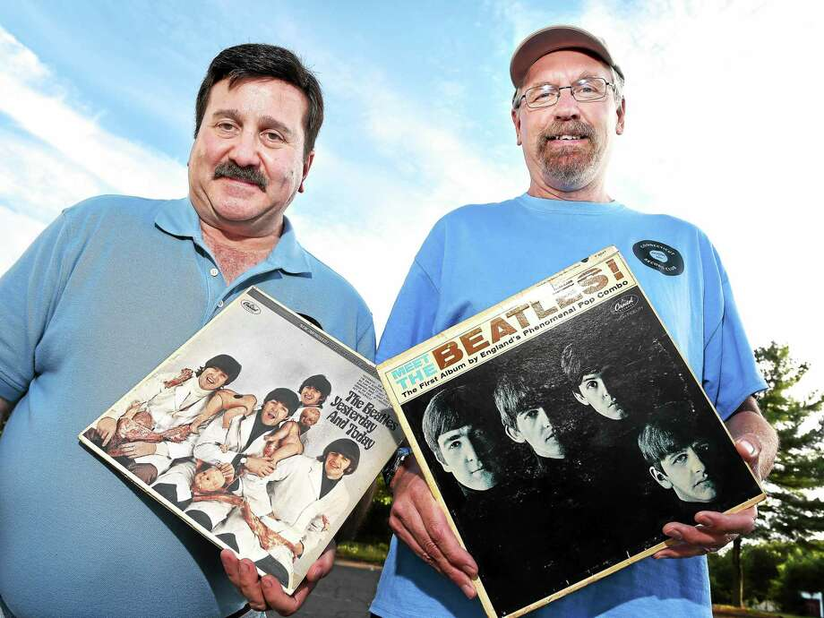 Connecticut Record Club members Joe Avitable, left, of East Haven and Rich Hall of Branford hold Beatles albums outside of the North Haven Congregational Church where the club meets on 9/21/2015. Hall is vice president of the club. Photo: Arnold Gold — New Haven Register