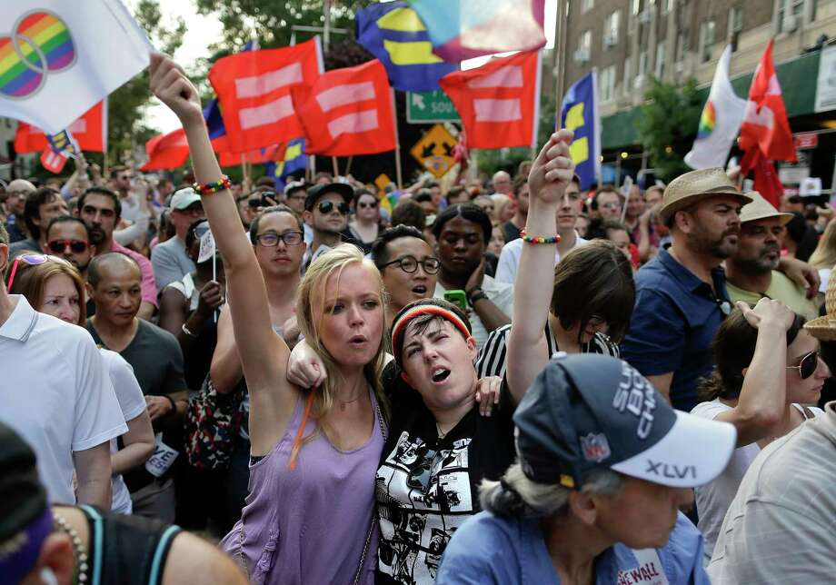 JULIE JACOBSON — ASSOCIATED PRESS  Emily Burke, left, and Lindsay Meeks react with hundreds of others gathered during a rally in Greenwich Village to celebrate the Supreme Court's ruling on gay marriage, Friday, June 26, 2015, in New York. Photo: AP / AP