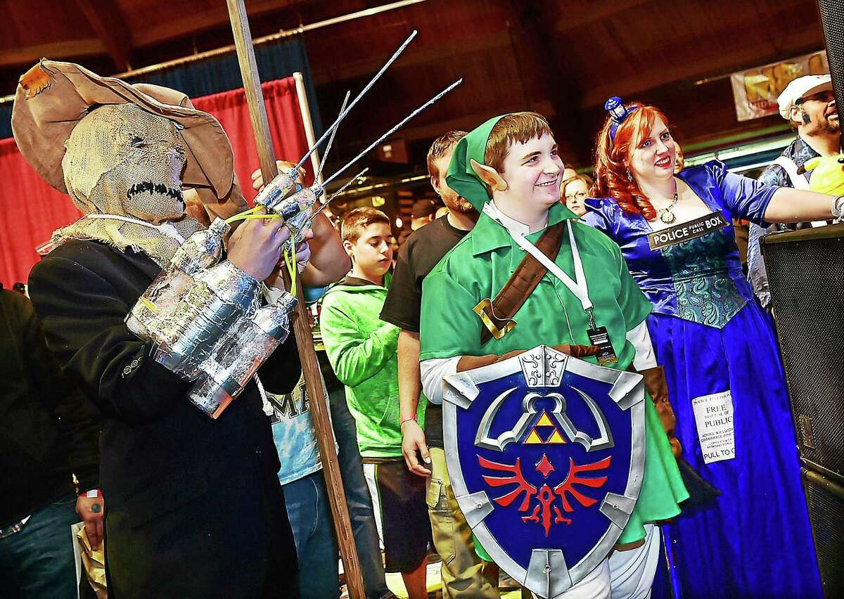 Bethel resident Ben Webb as the Scarecrow from Arkham Asylum and Fairfield resident Ian Konigsbert, dressed as Linkfrom the Legend of Zelda watch judges tabulate the scores Saturday, October 3, 2015, at the RetroWorld Expo at the Oakdale Theater in Wallingford. Konigsberg won the costume contest with Webb coming in second.