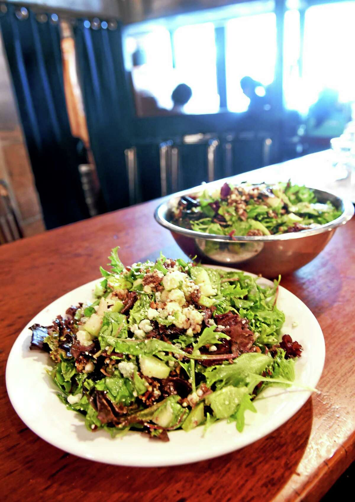 BAR on Crown Street in New Haven features their one and only BAR salad created by Gloria Hoder, the mother of the founder of BAR: mixed greens, caramelized pecans, pears, blue cheese, tossed in oil and vinegar.