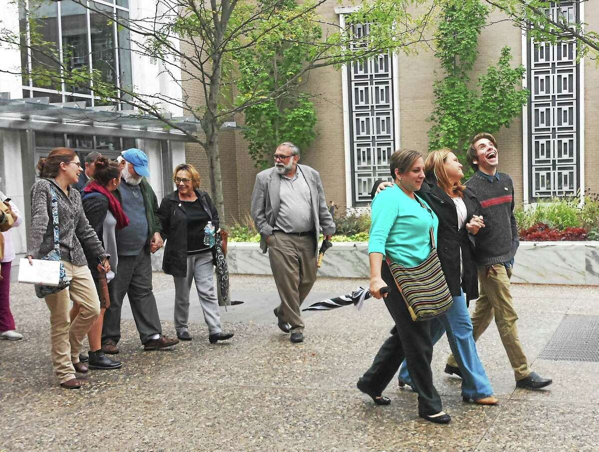 From left, Dawn Luddy, Jennifer Paul and Robert Hardy leave court in Hartford after the verdict Friday. Dawn and Jennifer are sisters of the late Kathy Hardy and Robert is her son.