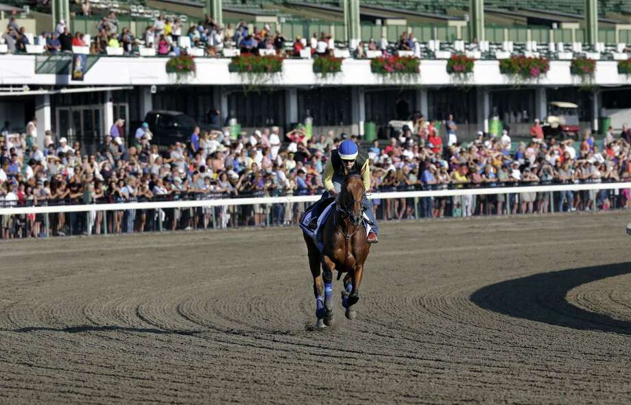 Mel Evans — The Associated Press  In front of a large crowd of fans, Triple Crown winner American Pharoah with Jorge Alvarez up trains at Monmouth Park in Oceanport, N.J., Saturday. American Pharoah is preparing for Sunday's running of the Haskell Invitational horse race. Photo: AP / AP