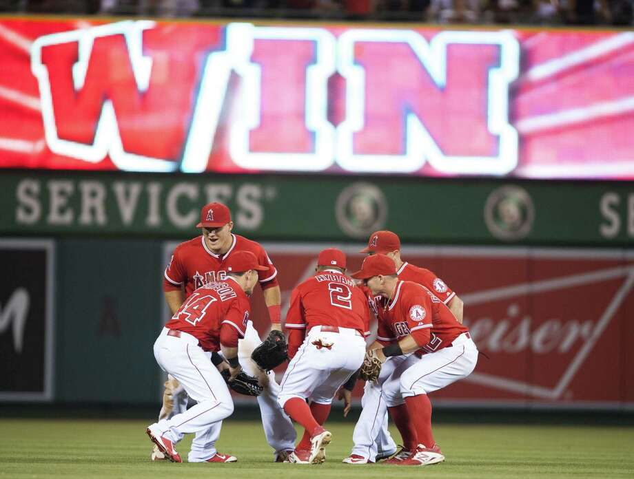 Los Angeles Angels players celebrate after they defeated the New York Yankees 2-1 on Tuesday in Anaheim, Calif. Photo: Kevin Sullivan — The Orange County Register   / The Orange County Register