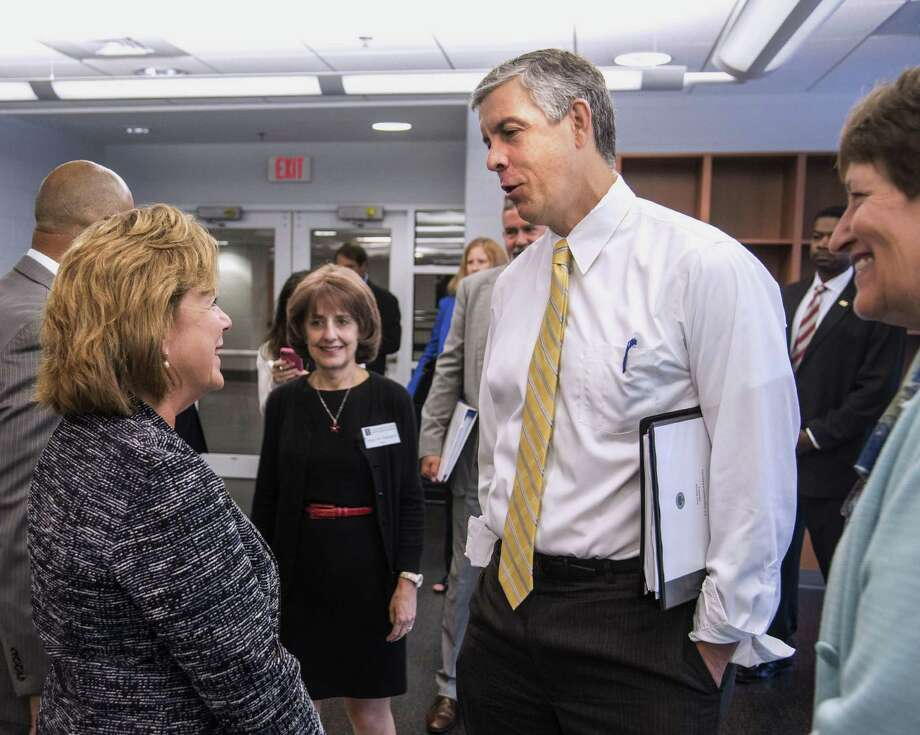 """U.S. Secretary of Education Arne Duncan, right, talks with University of Illinois interim Chancellor Barbara Wilson at the Activities and Recreation Center in Champaign, Ill., on Wednesday Sept. 16, 2015. Duncan was in town as part of his sixth annual """"Back to School Bus Tour.î Duncan hosted a roundtable discussion with UI students about resources available for those with disabilities. Photo: (John Dixon/The News-Gazette Via AP) / The News-Gazette"""
