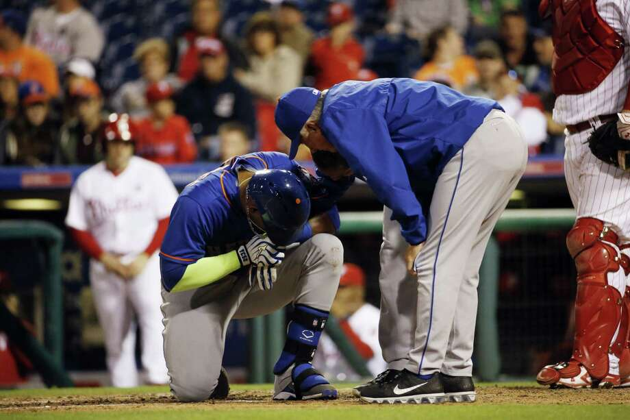 New York Mets' Yoenis Cespedes reacts after being hit by a pitch from Philadelphia Phillies' Justin De Fratus during the third inning of a baseball game, Wednesday, Sept. 30, 2015, in Philadelphia. (AP Photo/Matt Slocum) Photo: AP / AP
