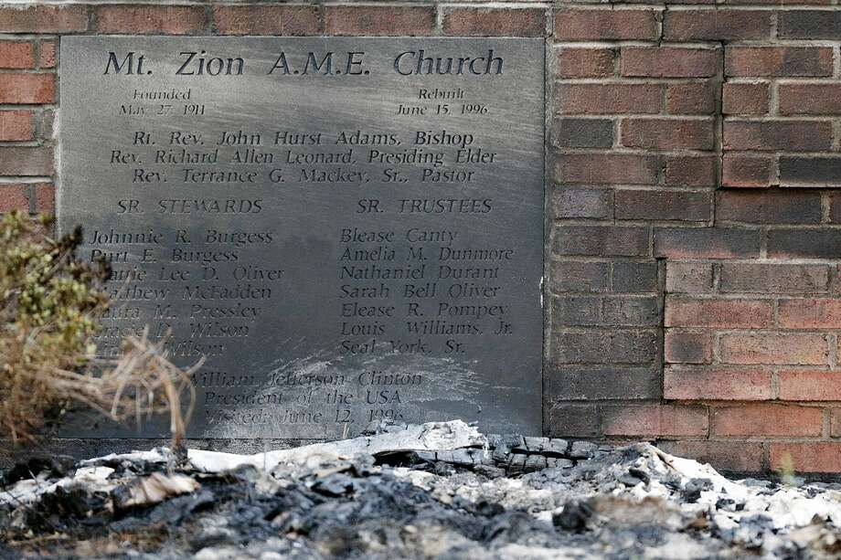 Ashes lie by a cornerstone outside Mount Zion African Methodist Episcopal Church, Wednesday, July 1, 2015, in Greeleyville, S.C. The African-American church, which was burned down by the Ku Klux Klan in 1995, caught fire Tuesday night, but authorities said arson is not the cause. (Veasey Conway/The Morning News via AP) Photo: AP / Florence Morning News
