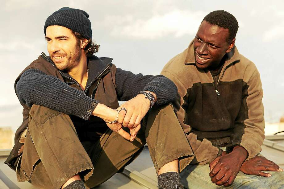 """Tahar Rahim, left, and Omar Sy in the French film """"Samba,"""" now playing at Madison Art Cinema. Photo: David Koskas - Broad Green Pictures    / THE WASHINGTON POST"""