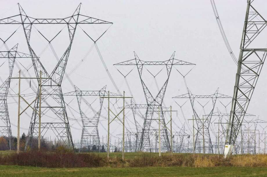 In this Oct. 29, 2009 photo, electric power lines cover the landscape in Levis, Quebec. Critics of proposals to import relatively clean hydropower from Quebec into the Northeastern United States worry that transmission lines will despoil the natural beauty of places like New Hampshire's White Mountains with power lines. Photo: Jacques Boissinot/The Canadian Press Via AP   / CP