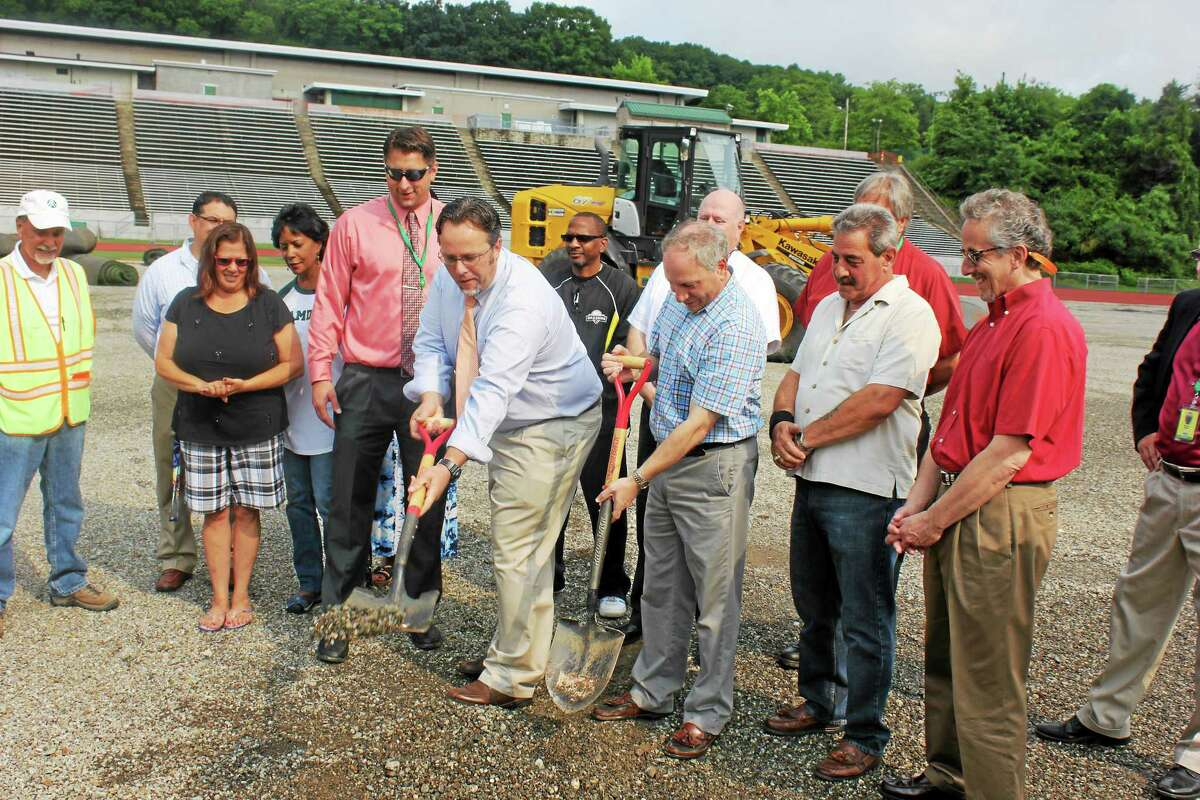 Mayor Curt Balzano Leng and Legislative Council President James Pascarella put the first ceremonial shovel in the ground Wednesday, officially kicking off the construction of new athletic fields at Hamden High School.