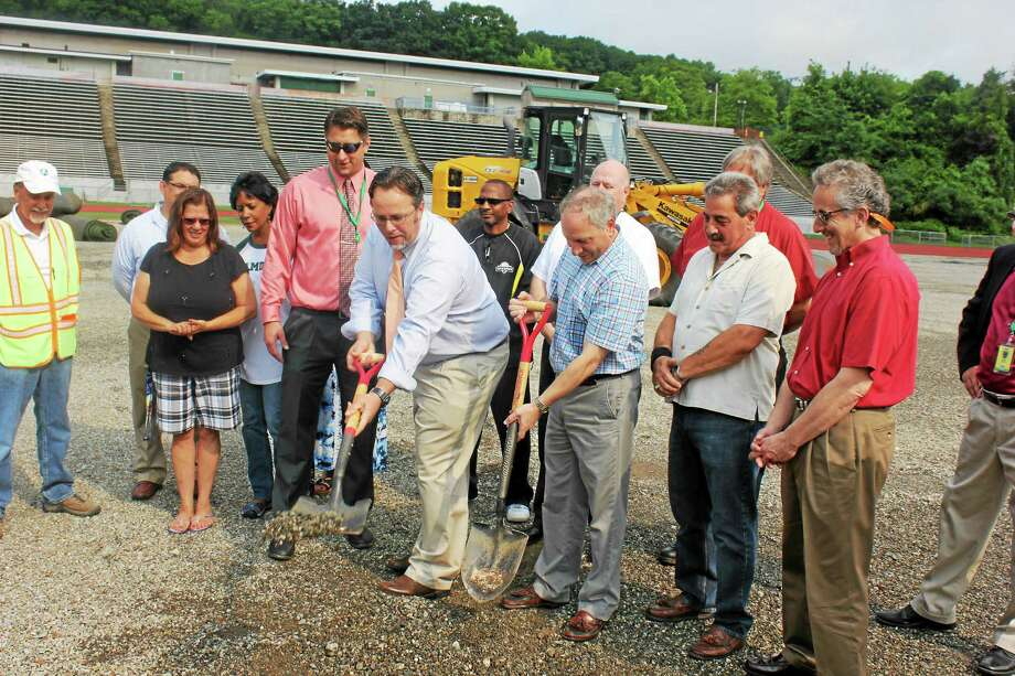 Mayor Curt Balzano Leng and Legislative Council President James Pascarella put the first ceremonial shovel in the ground Wednesday, officially kicking off the construction of new athletic fields at Hamden High School. Photo: Kate Ramunni - New Haven Register