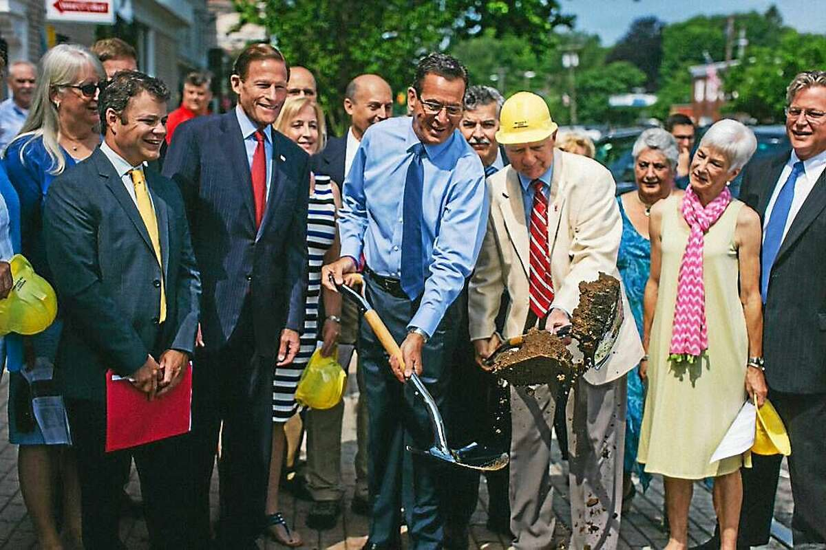 Gov. Dannel Malloy, center, and others celebrate a ground-breaking for Madison's downtown beautification project Wednesday.