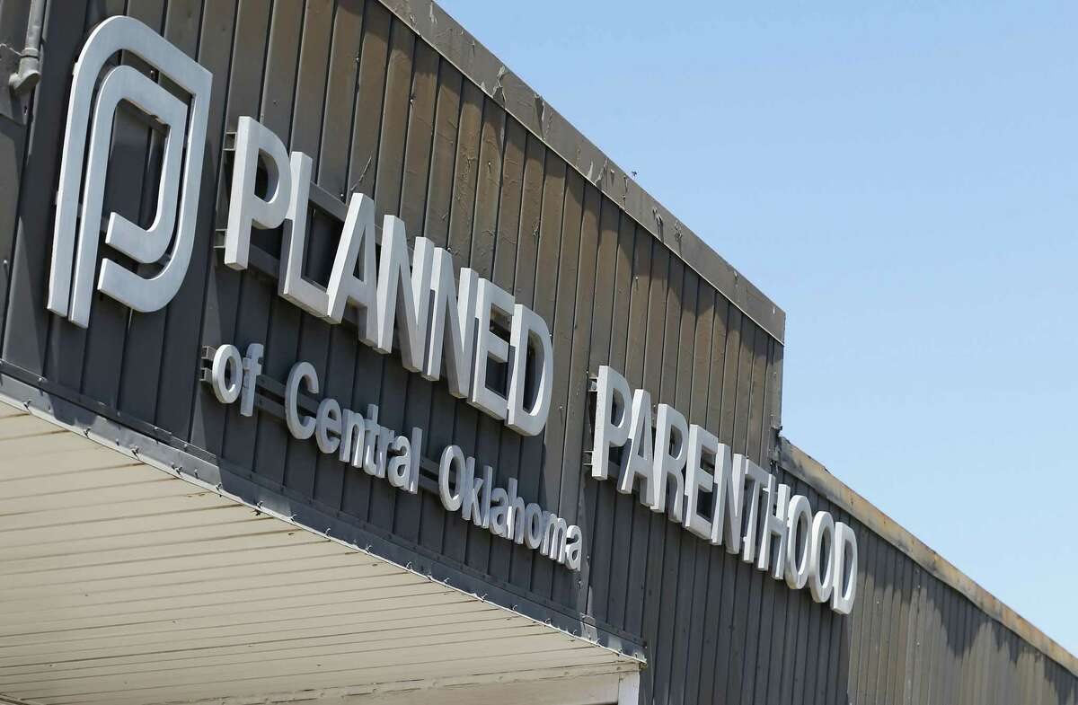 A sign at a Planned Parenthood Clinic is pictured in Oklahoma City Friday. U.S. Sen. James Lankford, R-Okla., a Baptist minister and fierce abortion opponent, has introduced a bill in the U.S. Senate that would end all federal funding for Planned Parenthood unless the organization stops performing abortions. The organization has become the focus of controversy after videos emerged showing Planned Parenthood officials bargaining over fetal body parts.