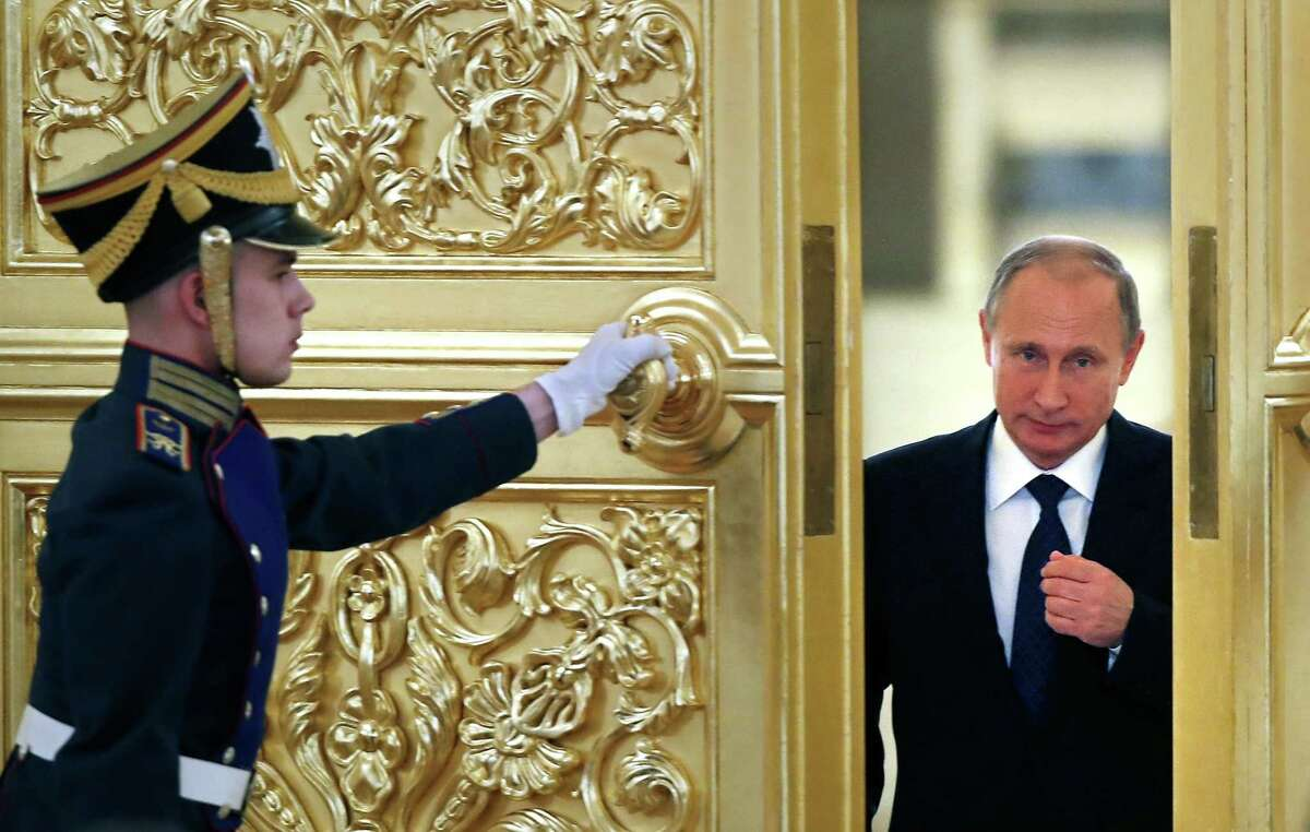 Russian President Vladimir Putin, right, enters the Alexadrovsky Hall to head a meeting of the Presidential Council for Civil Society and Human Rights at the Kremlin in Moscow, Russia on Oct. 1, 2015.