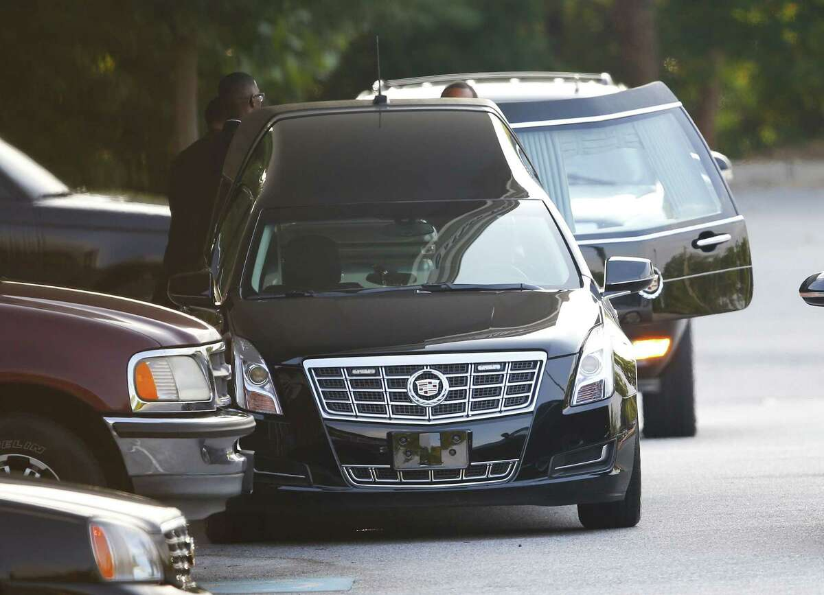 A hearse is unloaded before the funeral service for Bobbi Kristina Brown Saturday in Alpharetta, Ga. Brown, the only child of Whitney Houston and R&B singer Bobby Brown, died in hospice care July 26, about six months after she was found face-down and unresponsive in a bathtub in her suburban Atlanta townhome.