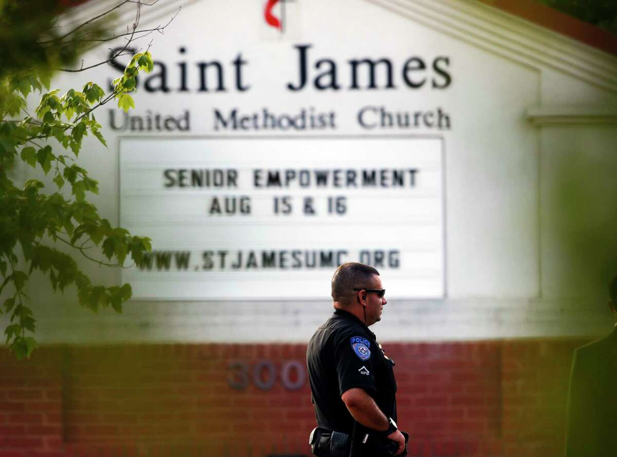 A police officer stands guard at the entrance to St. James United Methodist Church, where funeral services for Bobbi Kristina Brown took place Saturday in Alpharetta, Ga. Brown, the only child of Whitney Houston and R&B singer Bobby Brown, died in hospice care July 26, about six months after she was found face-down and unresponsive in a bathtub in her suburban Atlanta townhome.