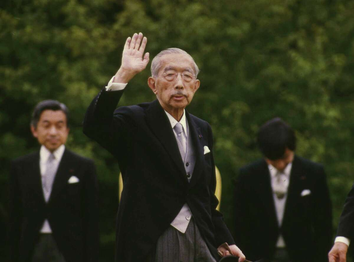 In this May 19, 1988, file photo, then Emperor of Japan Hirohito waves as then Crown Prince Akihito, left, looks on during the imperial garden party at the Akasaka Imperial Gardens in Tokyo. The original recording of Hirohito's war-ending speech has come back to life in digital form, ahead of the 70th anniversary of the speech and the war's end.